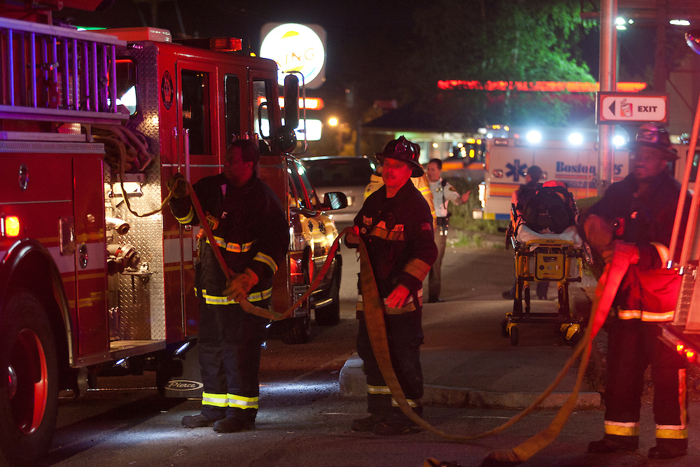 Boston, MA 5/26/11.Boston firefighters rack up a hose line outside the Dunkin Donuts at 1630 VFW Parkway early Thursday morning.  A fire started in the rear of the building but was quickly contained, officials said..Alex Jones / For The West Roxbury Transcript
