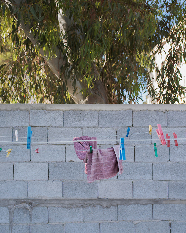 A towel, left forgotten, on a clothes line at the former refugee camp in the port of Lakki.<br /> <br /> The camp was opened by volunteers in the summer of 2015 and later that year UNHCR and MSF expanded it and provided additional tents, toilets and other facilities. The camp was closed soon after the opening of a 'Hotspot' (EU-run migrant's reception centres) camp in Lepida in February 2016.