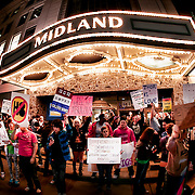 At a screening of the film Red State at the Midland Theatre in Kansas City, a counter-protest of the Westboro Baptist Church's anti-gay protest across the street.