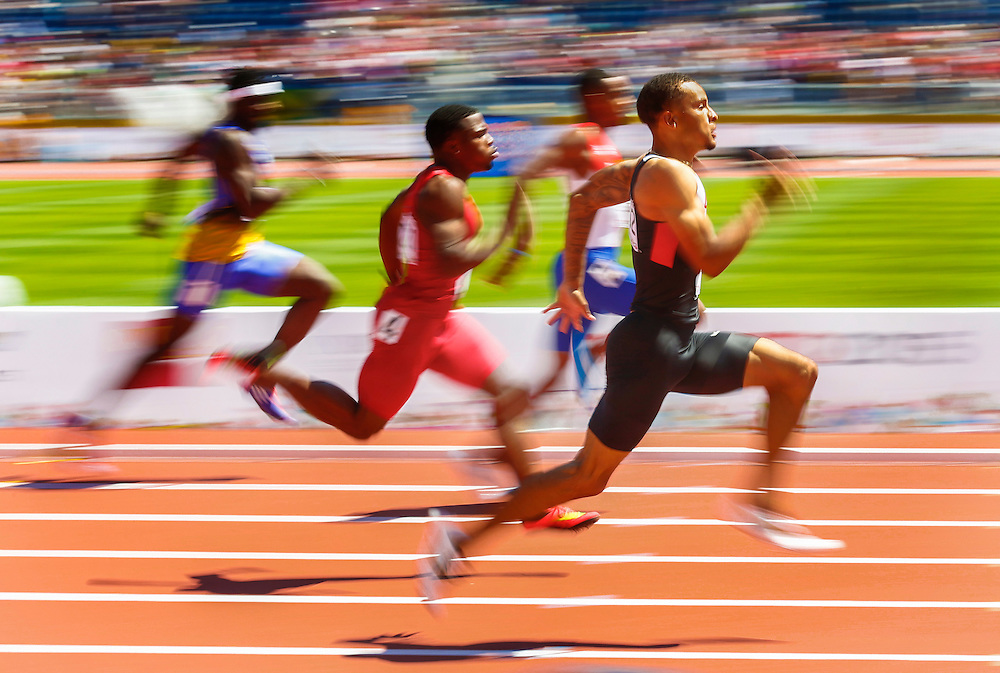 Andre De Grasse of Canada sprints during the men's 200m heats during the athletics at the Pan Am Games in Toronto, Thursday July 23, 2015.    THE CANADIAN PRESS/Mark Blinch