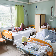 INDIVIDUAL(S) PHOTOGRAPHED: N/A. LOCATION: St. Damien Hospital, Nos Petits Frères et Sœurs, Tabarre 41 Commune, Haïti. CAPTION: Young moms and their babies rest in the maternity ward at St. Damien Hospital.