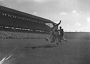 Player kicks ball towards goal during the All Ireland Senior Gaelic Football Final Down v. Offaly in Croke Park on the 24th September 1961. Down 3-6 Offaly 2-8.
