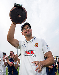 Essex's Alastair Cook celebrates with the Division 1 Championship trophy after day three of the Specsavers County Championship, Division One match at the Cloudfm County Ground, Chelmsford.