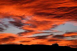 © Licensed to London News Pictures.17/11/15<br /> Saltburn, UK. <br /> <br /> A spectacular sunrise lights up clouds over cottages on the east coast of England near Saltburn in Cleveland.<br /> <br /> Photo credit : Ian Forsyth/LNP