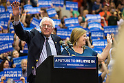 Jane and Bernie Sanders wave to the crowd after his campaign rally at Penn State's Rec Hall.
