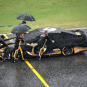 Crew members of the Marcos Ambrose (9) team push his race car back to the garage at the conclusion of the 56th Annual NASCAR Coke Zero 400 race at Daytona International Speedway on Sunday, July 6, 2014 in Daytona Beach, Florida.  (AP Photo/Alex Menendez)