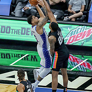 ORLANDO, FL - APRIL 12: Rudy Gay #22 of the San Antonio Spurs blocks a shot attempt by Chuma Okeke #3 of the Orlando Magic during the first half at Amway Center on April 12, 2021 in Orlando, Florida. NOTE TO USER: User expressly acknowledges and agrees that, by downloading and or using this photograph, User is consenting to the terms and conditions of the Getty Images License Agreement. (Photo by Alex Menendez/Getty Images)*** Local Caption *** Rudy Gay; Chuma Okeke