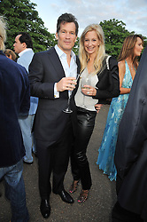 LOUIS BACON and his wife GABRIELLE at the annual Serpentine Gallery Summer Party sponsored by Canvas TV  the new global arts TV network, held at the Serpentine Gallery, Kensington Gardens, London on 9th July 2009.
