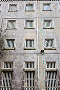 The lines used for passing items between cell windows of one of the main wings at HMP/YOI Portland, a resettlement prison with a capacity for 530 prisoners. Dorset, United Kingdom.