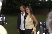 Dan McMillan and Jade Jagger. Serpentine Gallery Summer party in a glass and steel pavilion designed by Toyo Ito and Arup. . tuesday 9 July 2002. © Copyright Photograph by Dafydd Jones 66 Stockwell Park Rd. London SW9 0DA Tel 020 7733 0108 www.dafjones.com