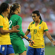 Brazil forward Raquel (19) and Brazil goalkeeper Luciana (12) talk during a women's soccer International friendly match between Brazil and the United States National Team, at the Florida Citrus Bowl  on Sunday, November 10, 2013 in Orlando, Florida. The U.S won the game by a score of 4-1.  (AP Photo/Alex Menendez)