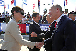 French president Nicolas Sarkozy, his wife Carla Bruni-Sarkozy, Israeli president Shimon Peres, Prime Minister Ehud Olmert are seen minutes before an Israeli soldier shoots himself during a departure ceremony for French president Nicolas Sarkozy at Ben Gurion International Airport on June 24, 2008 in Tel Aviv, Israel. Photo by Balkis Press/ABACAPRESS.COM