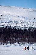 Fishing on frozen lake, fishermen, snowy landscape, recreation