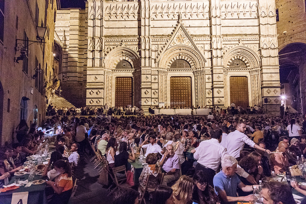 Italy, Siena, the Palio: the night before the Palio, every contrada make a private huge dinner for all the people of the contrada plus some guests. this is one of the way to support economically the activityies of the contrada