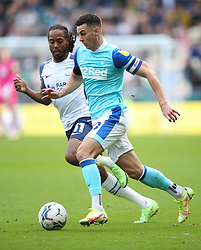 Preston North End's Daniel Johnson (left) and Derby County's Tom Lawrence battle for the ball during the Sky Bet Championship match at Deepdale Stadium, Preston. Picture date: Saturday October 16, 2021.