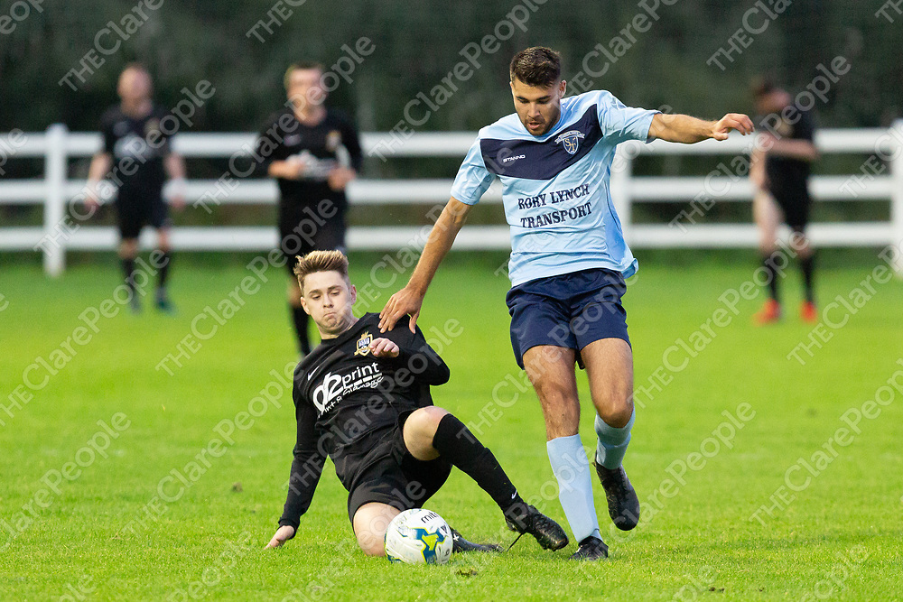 Shannon Town C's Dion Ketan is slide tackled by Ennis Don's Dean Malone