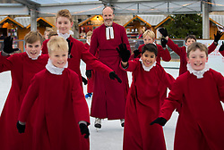 © Licensed to London News Pictures. 18/11/2016. Winchester, UK. The Choristers of Winchester Cathedral try out the seasonal ice rink with The Reverend Canon Dr Roland Riem, Vice-Dean (C). Celebrating it's 10th anniversary, the ice rink opens to the public from today until January 2, 2017. Photo credit: Peter Macdiarmid/LNP