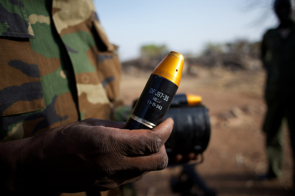 May 01, 2012 - Kauda, Nuba Mountains, South Kordofan, Sudan: A Sudan People?s Liberation Movement (SPLA-N) commander shows a grenade captured from Sudan's Armed Forces (SAF) during combat in the rebel-held territory of the Nuba Mountains in South Kordofan. The commander claims that this type of grenades are been used by SAF to deliver chemical attacks on his men...SPLA-North, a historical ally of SPLA, South Sudan's former rebel forces, has since last June being fighting the Sudanese Army Forces (SAF) over the right to autonomy and of the end of persecution of Nuba people by the regime of President Bashir. (Paulo Nunes dos Santos/Polaris)