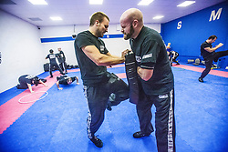 Students kneeing a pad as Stef Noij, KMG Instructor from the Institute Krav Maga Netherlands, takes the IKMS G Level Programme seminar today at the Scottish Martial Arts Centre, Alloa.
