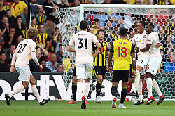 Manchester United's Chris Smalling (second right) celebrates scoring his side's second goal of the game with team-mates Paul Pogba (right) during the Premier League match at Vicarage Road, Watford