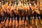 Haunch leg of Iberico Jamon specialty ham in butcher shop Mulas Carnicerias in Salamanca, Spain