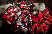 Kamol, 7 days old son of Er Ali Boi - Er Ali Boi's two previous wives died in labor. Afghan Kyrgyz community has the world's highest maternal mortality rate..The Kyrgyz settlement of Ech Keli, above Chaqmaqtin lake, Er Ali Boi's camp...Trekking through the high altitude plateau of the Little Pamir mountains, where the Afghan Kyrgyz community live all year, on the borders of China, Tajikistan and Pakistan.