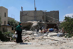 August 16, 2017 - Ramallah, West Bank, Palestinian Territory - A woman walks next to the remains of the family house of Palestinian assailant Omar Alabed after it was demolished by Israeli troops in the West Bank village of Khobar near Ramallah. Security forces demolished the home of Palestinian terrorist who killed three Israelis during a West Bank home invasion and stabbing attack last month, as relatives faced charges for failing to stop the deadly assault.  (Credit Image: © Shadi Hatem/APA Images via ZUMA Wire)