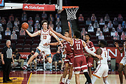 Southern California Trojans guard Drew Peterson (13) attempts a pass during an NCAA men's basketball game against the Stanford Cardinal, Wednesday, March 3, 2021, in Los Angeles. USC defeated Stanford 79-42. (Jon Endow/Image of Sport)