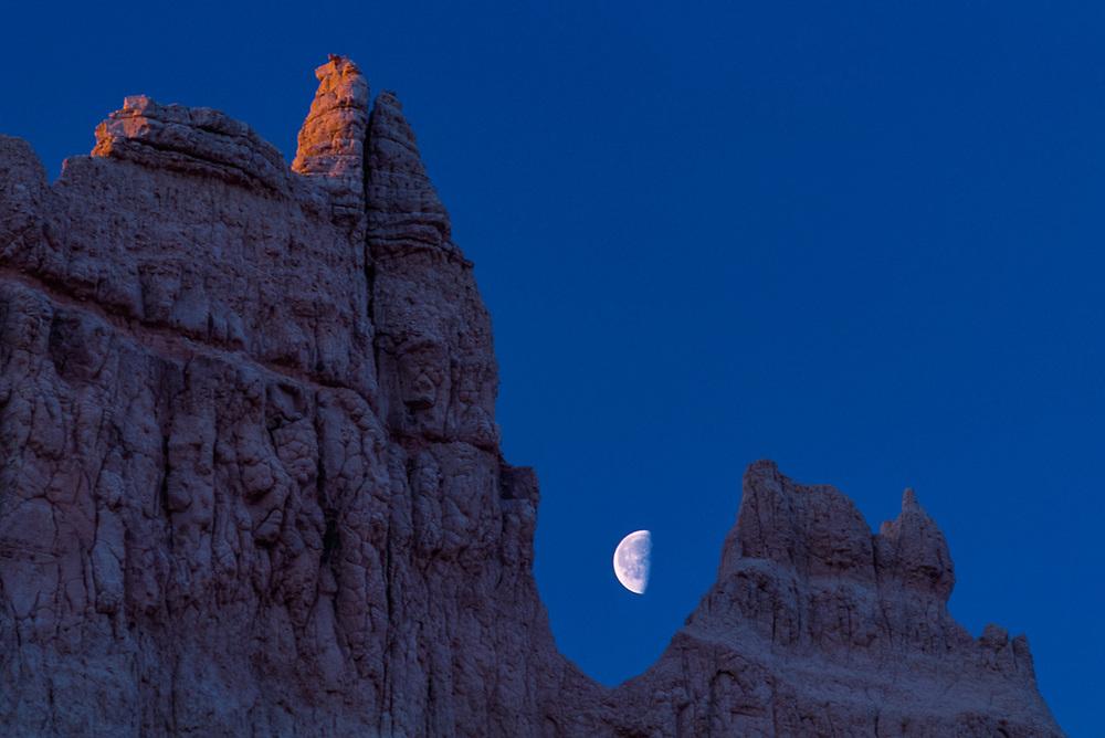 Moon and spires, morning light, Norbeck Pass area, Badlands National Park, South Dakota, USA