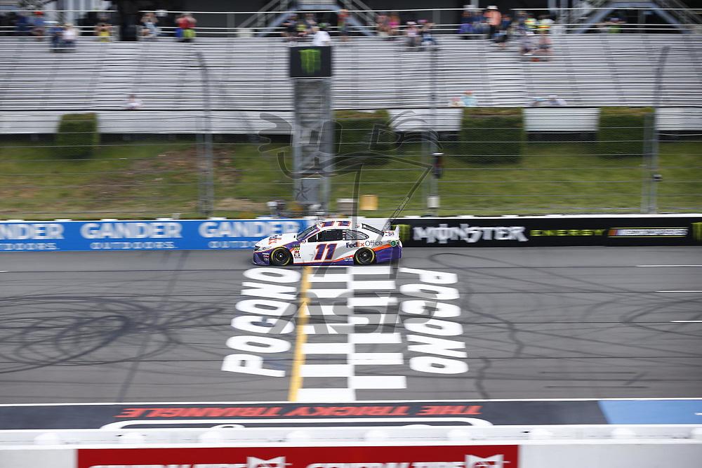 Denny Hamlin (11) takes to the track to practice for the Pocono 400 at Pocono Raceway in Long Pond, Pennsylvania.