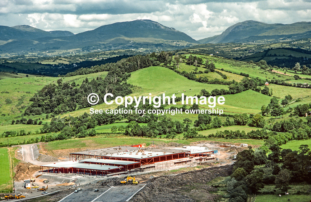 Aeral photograph of the Abbott Ireland factory under construction at Lurganboy, near Donegal Town, Rep of Ireland, in 1979. Barnesmore Gap can be seen in the distance. 119790166b.<br /> <br /> Copyright Image from Victor Patterson, Belfast, UK<br /> <br /> t: +44 28 9066 1296 (from Rep of Ireland 048 9066 1296)<br /> m: +44 7802 353836<br /> e: victorpattersonbelfast@gmail.com<br /> <br /> www.images4media.com<br /> <br /> Please see my full Terms and Conditions of Use at https://www.images4media.com/p/terms-conditions - it is IMPORTANT that you familiarise yourself with them.<br /> <br /> Images used online incur an additional cost. This cost should be agreed in writing in advance. Online images must be visibly watermarked i.e. © Victor Patterson or that of the named photographer within the body of the image. The original metadata must not be deleted from images used online.<br /> <br /> This image is only available for the use of the download recipient i.e. television station, newspaper, magazine, book publisher, etc, and must not be passed on to a third party. It is also downloaded on condition that each and every usage is notified within 7 days to victorpattersonbelfast@gmail.com.<br /> <br /> The right of Victor Patterson (or the named photographer) to be identified as the author is asserted in accordance with The Copyright Designs And Patents Act (1988). All moral rights are asserted.