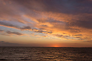 Sunset; Gurnard; Solent; Isle of Wight; UK; sundown; sea; clouds