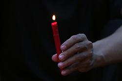 QUEZON Quezon City, December 1, 2016 (Xinhua) -- A man holds a lit candle in observance of the World AIDS Day in Quezon City, the Philippines, December 1, 2016. People around the world are observing the World AIDS Day to raise awareness and prevention on HIV/AIDS. (Xinhua/Rouelle Umali) (Credit Image: © Xinhua via ZUMA Wire)