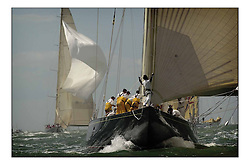 Endevour leads Shamrock into the leeward mark the classic 'J' class. Thousands of craft have flocked to the Cowes and the Solent to witness the 150th Anniversary of the Americas Cup. ..Marc Turner / PFM Pictures