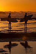 Surfers watching surf at Dawn, Susan Gilmore Beach, Newcastle, Australia