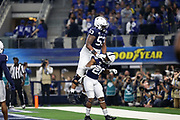 Penn State Nittany Lions running back Devyn Ford (28) and left tackle Rasheed Walker (53) celebrate a touchdown against the Memphis Tigers during the game of the NCAA Cotton Bowl Classic football game, Saturday, Dec. 28, 2019, in Arlington, Texas. Penn State defeated Memphis 53-39. (Mario Terrana/Image of Sport)