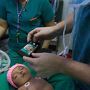 CAPTION: After the operation, the doctors take Allison's photograph to show the changes. This will be submitted to Smile Train. LOCATION: Hospital Escuela, Tegucigalpa, Honduras. INDIVIDUAL(S) PHOTOGRAPHED: Allison Juliet Lemus Martinez.