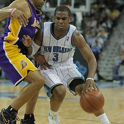23 December 2008:  New Orleans Hornets guard Chris Paul (3) drives back Los Angeles Lakers guard Derek Fisher (2) during a 100-87 loss by the New Orleans Hornets to the Los Angeles Lakers at the New Orleans Arena in New Orleans, LA. .
