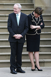 First Minister Arlene Foster (right) and Deputy First Minister Martin McGuinness await the arrival of Colombia's president Juan Manuel Santos at Stormont Castle, Belfast, during a state visit.