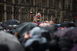 © Licensed to London News Pictures . 22/02/2015 .  Manchester , UK . The dragon makes its way through crowds on Princess Street . Crowds stand out in the snow to watch Chinese New Year celebrations in Manchester today ( Sunday 22nd February 2015) . Photo credit : Joel Goodman/LNP