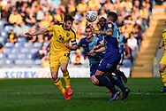 James Henry of Oxford United heads the ball under pressure during the EFL Sky Bet League 1 match between Oxford United and Wycombe Wanderers at the Kassam Stadium, Oxford, England on 30 March 2019.