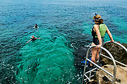 Snorkeling in the tropical aqua waters of Negril, Jamaica.