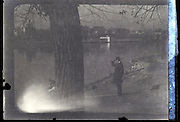 fading image of person standing near water 1930s