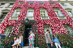 Celebrating the Chelsea Flower Show, after its recent £55 million facelift Annabel's Nightclub in Berekeley Square, Mayfair, has its entire facade covered in pink and red flowers. London, May 24 2018.