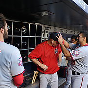 Bryce Harper, (left), Washington Nationals, in the dugout, watches as Matt Williams, Washington Nationals Manager,  has his head checked by Anthony Rendon before the New York Mets Vs Washington Nationals MLB regular season baseball game at Citi Field, Queens, New York. USA. 31st July 2015. Photo Tim Clayton