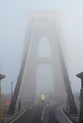 © Licensed to London News Pictures; 27/11/2020; Bristol, UK. Winter fog shrouds the Clifton Suspension Bridge over the Avon Gorge during the Covid-19 lockdown in England during the coronavirus pandemic. Bristol with one of the highest rates of Covid-19 infection in the country has been placed in the highest risk category of tier 3 to come into effect after lockdown ends on 02 December. Photo credit: Simon Chapman/LNP.