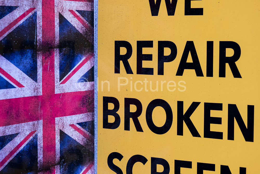 Union Jack flags outside a shop which repairs broken phone screens and is reminiscent of the phrase Broken Britain on Oxford Street on 28th January 2021 in London, United Kingdom. Broken Britain is a term which has been used by the Conservative Party to describe a perceived widespread state of social decay in the United Kingdom.