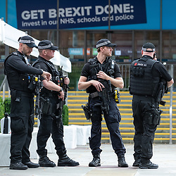 © Licensed to London News Pictures . 28/09/2019. Manchester, UK. Armed police provide security outside the Conservative Party Conference at the Manchester Central Exhibition Centre as arrivals are due at the start of the conference . Photo credit: Joel Goodman/LNP