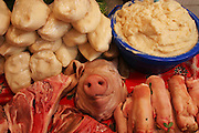 Pig head, feet, pork chops and lard in a meat market stall of the municipal market, Cuernavaca, Morelos, Mexico.