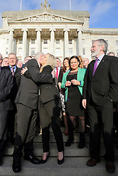 © Licensed to London News Pictures. STORMONT BELFAST - 23 JAN 2017: Sinn Fein's Michelle O'Neill (centre) gets a hug from Martin McGuinness, while stood next to Gerry Adams (right), on the steps of Stormont after being named as the new leader of Sinn Fein in the North, taking over from former deputy first minister Martin McGuinness who has retired due to illness. Photo credit: London News Pictures.